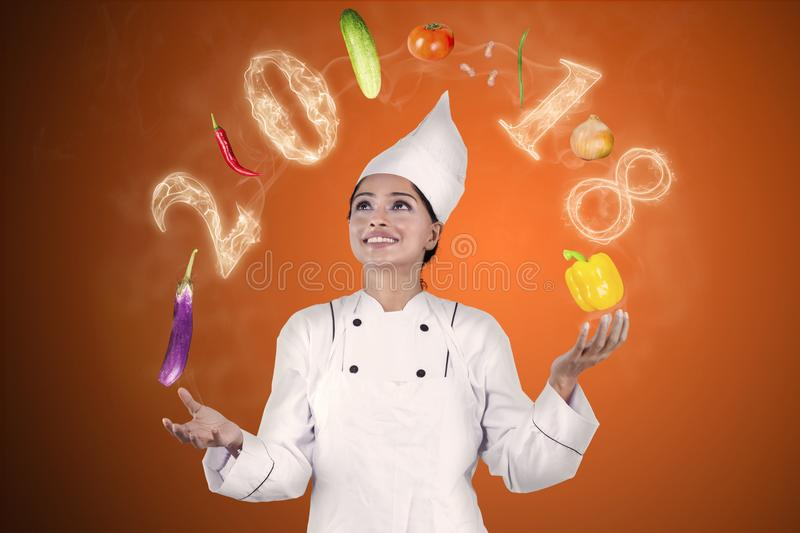 Magician chef juggling food ingredients stock photo