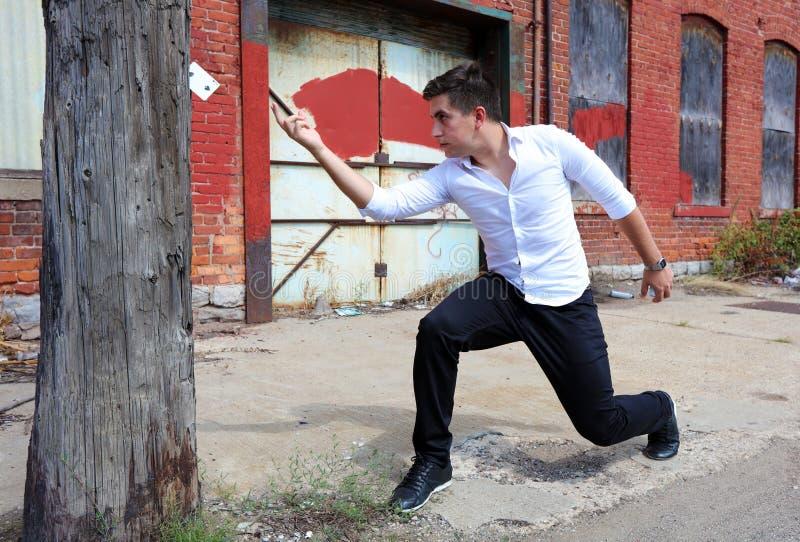 Magician at Detroit Michigan doing street magic in abandoned building at the motor city stock photo