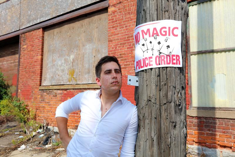 Magician at Detroit Michigan doing street magic in abandoned building at the motor city stock images