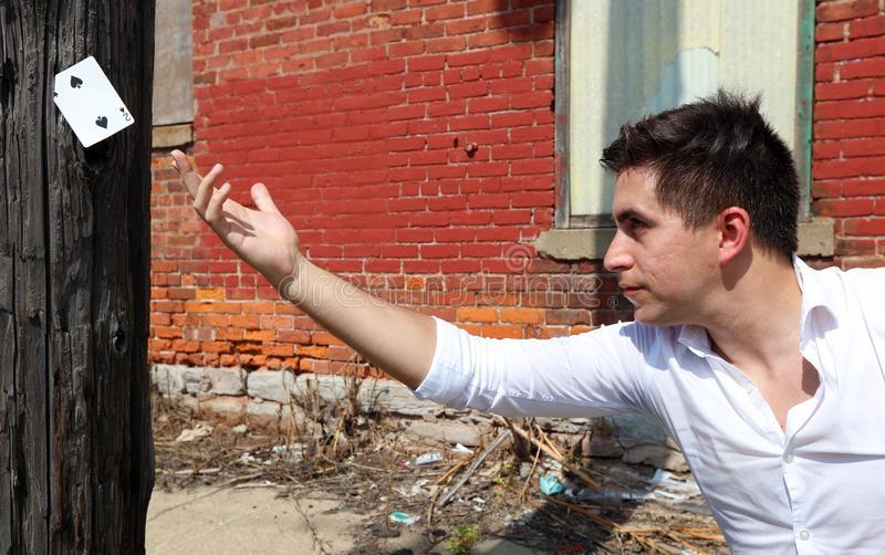 Magician at Detroit Michigan doing street magic in abandoned building at the motor city stock photo
