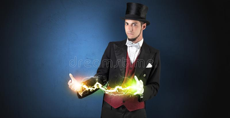 Magician energy between his hands. Magician sparkling super power between his two hands royalty free stock photo