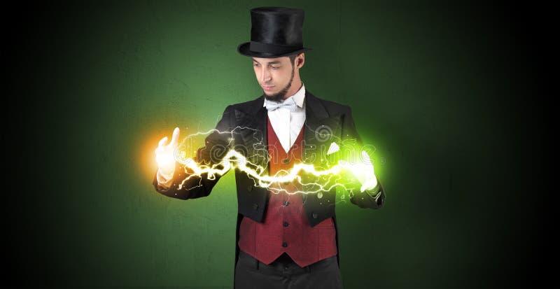 Magician energy between his hands. Magician sparkling super power between his two hands stock image