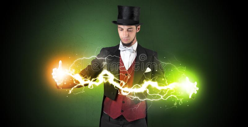 Magician energy between his hands. Magician sparkling super power between his two hands royalty free stock images