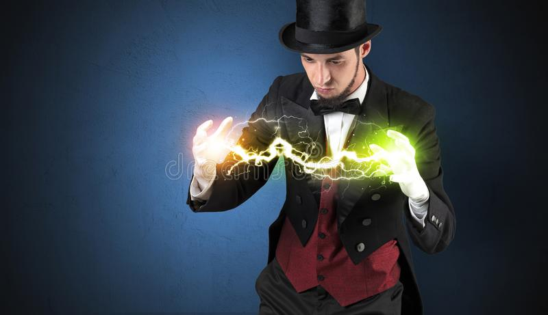 Magician energy between his hands. Magician sparkling super power between his two hands stock photos