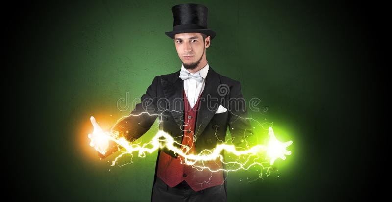 Magician energy between his hands. Magician sparkling super power between his two hands royalty free stock photos