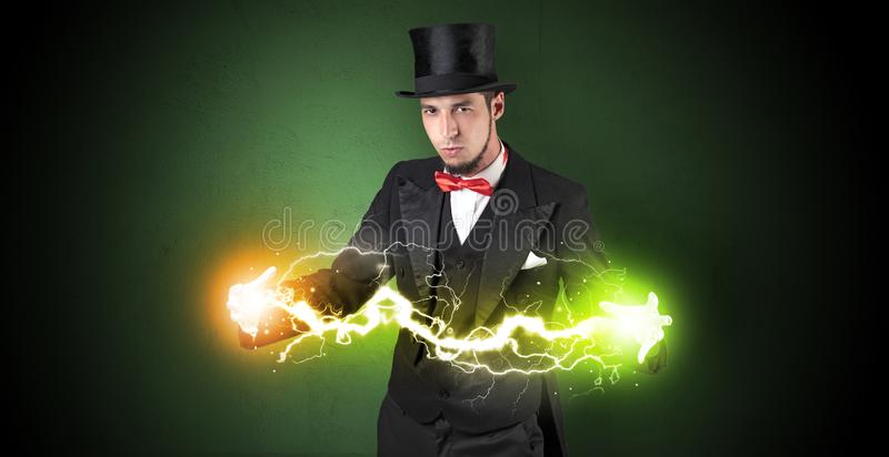 Magician energy between his hands. Magician sparkling super power between his two hands stock photography