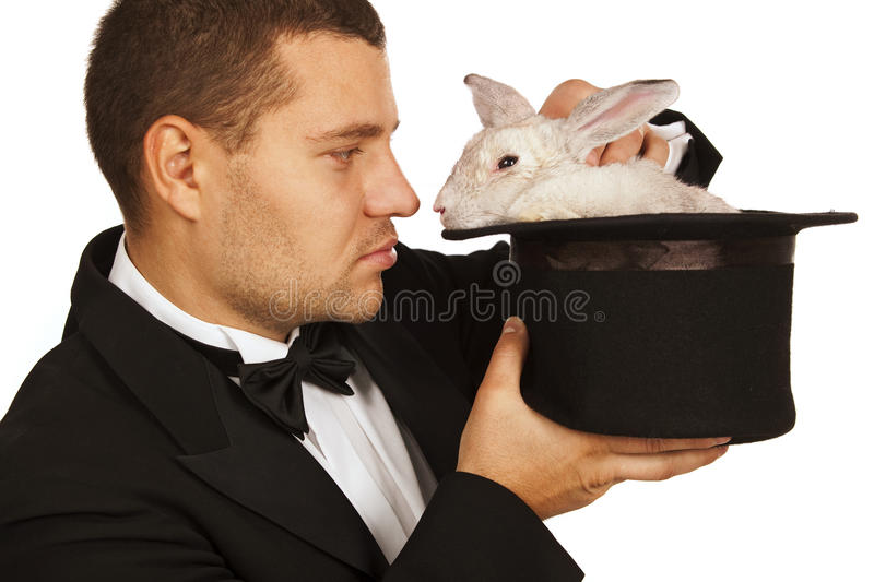 Magician face to face with a rabbit in a top hat royalty free stock image