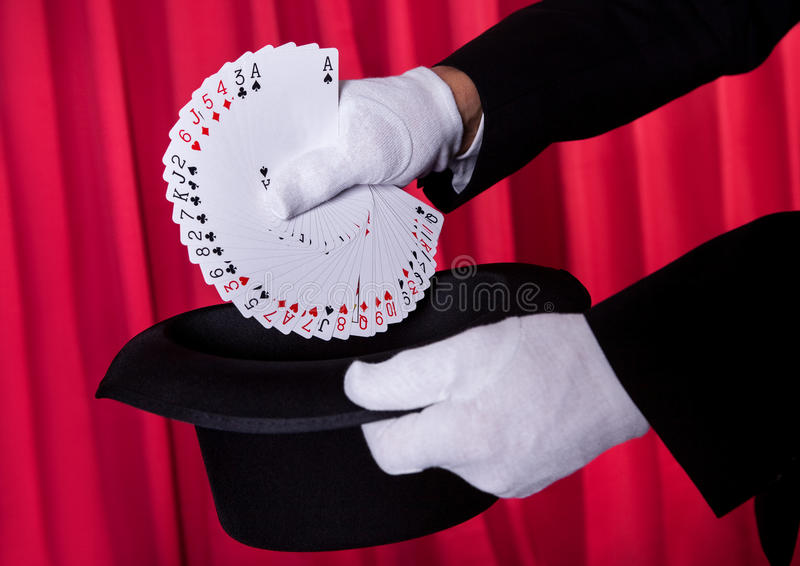 Magician Hand Holding Fanned Deck Of Cards stock photography