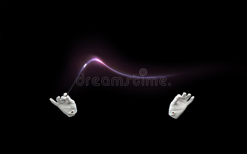 Magician hands with magic wand showing trick stock photos