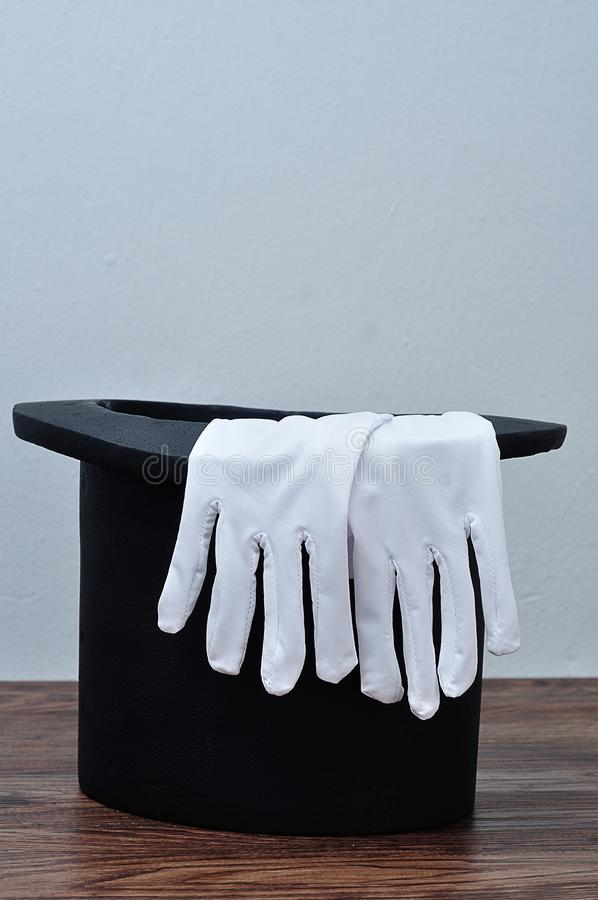 A magician hat with a pair of gloves royalty free stock image