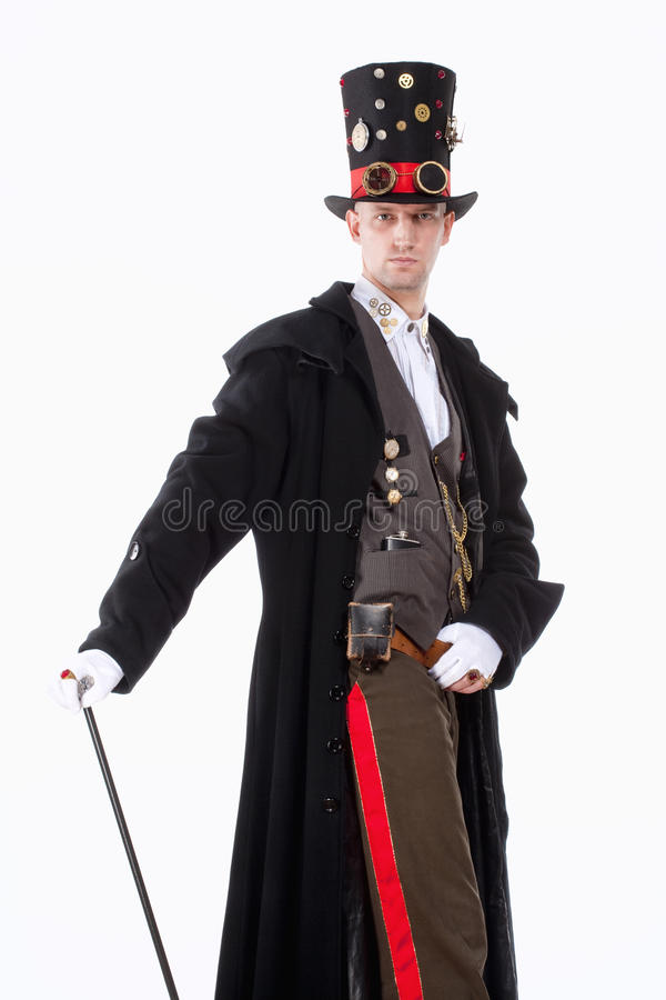 Magician with High Hat, Long Coat and Clock Parts Details. Portrait of a Magician with High Hat, Long Coat and Clock Parts Details royalty free stock images