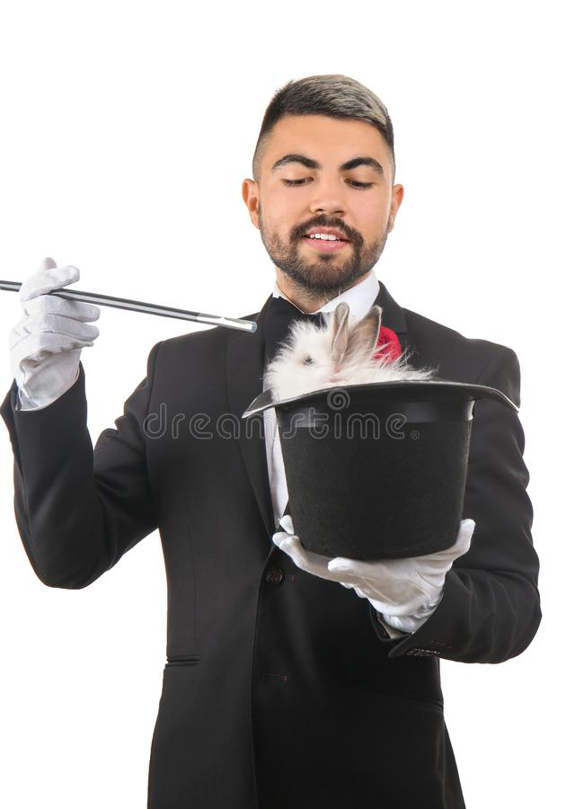 Magician holding hat with rabbit on white background royalty free stock photos