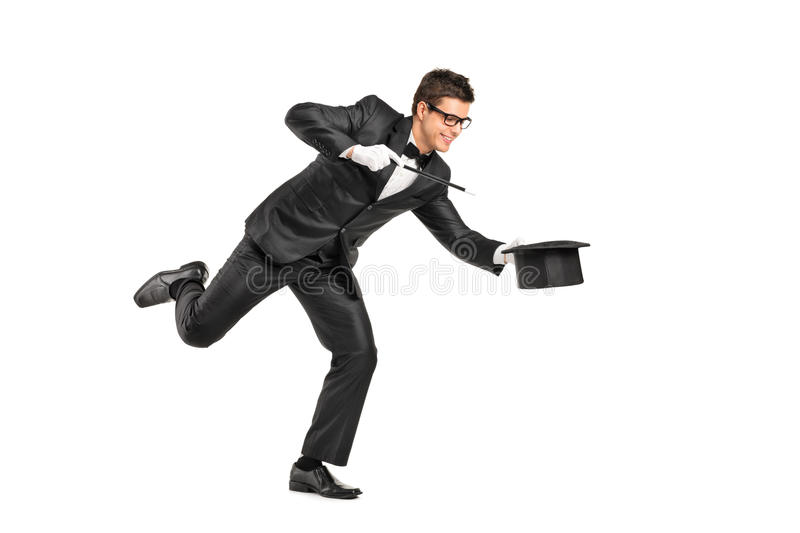 Download Magician Holding A Magic Wand And Gesturing Stock Photo - Image of male, hold: 23207538
