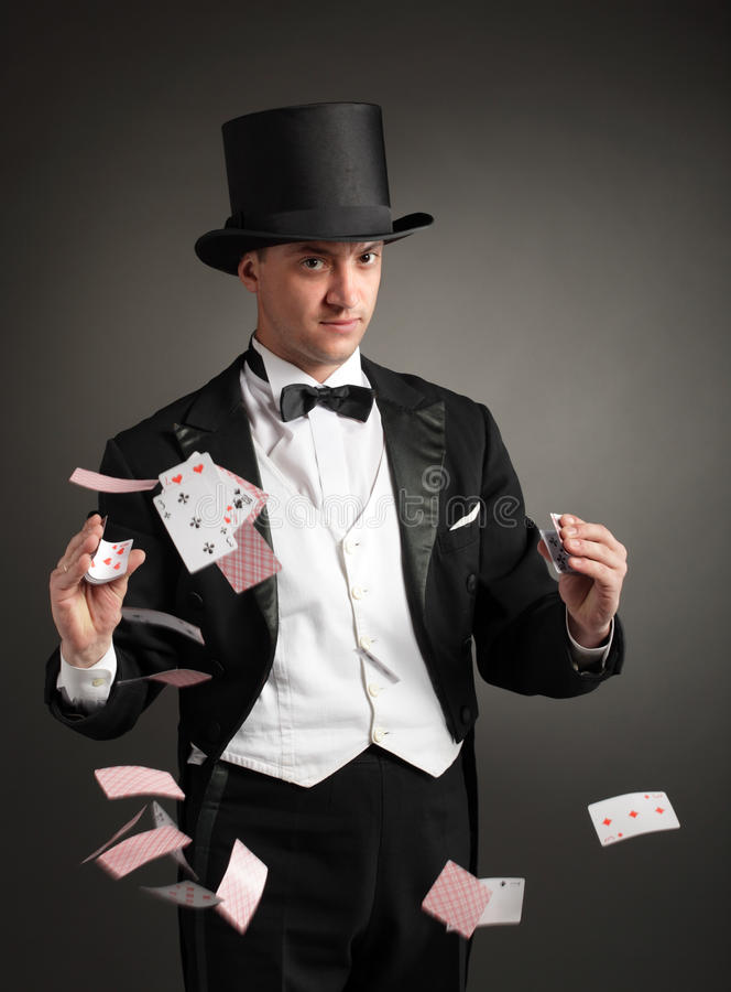 Magician juggle cards. On black background stock photography