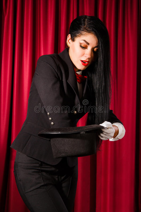 Magician looking for a rabbit in a hat royalty free stock photos