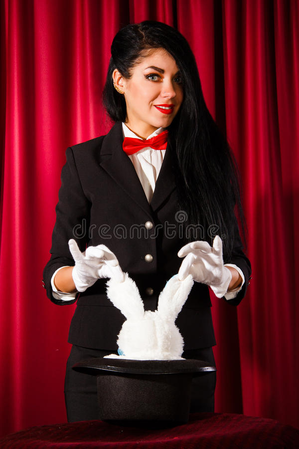 Magician with a rabbit in a hat royalty free stock photo