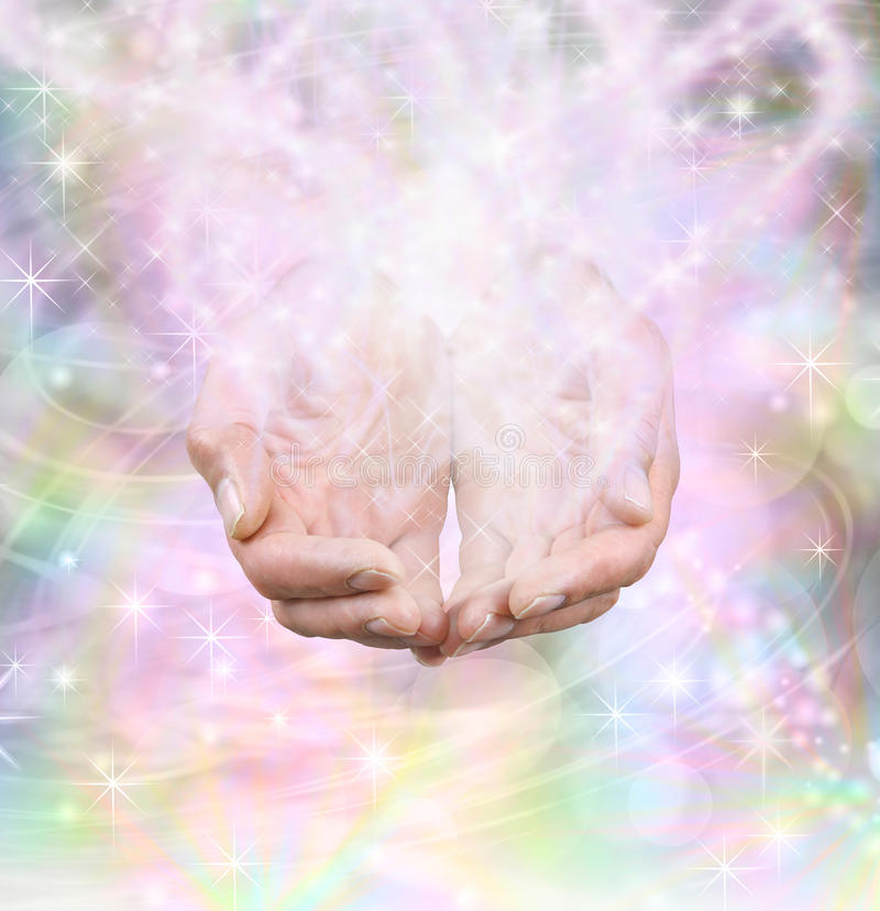 Magician's Magic. Male hands cupped emerging from swirling rainbow colored background with energy formation and sparkles stock images