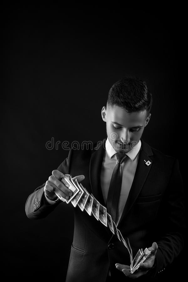 Magician Showing Trick With Cards stock image