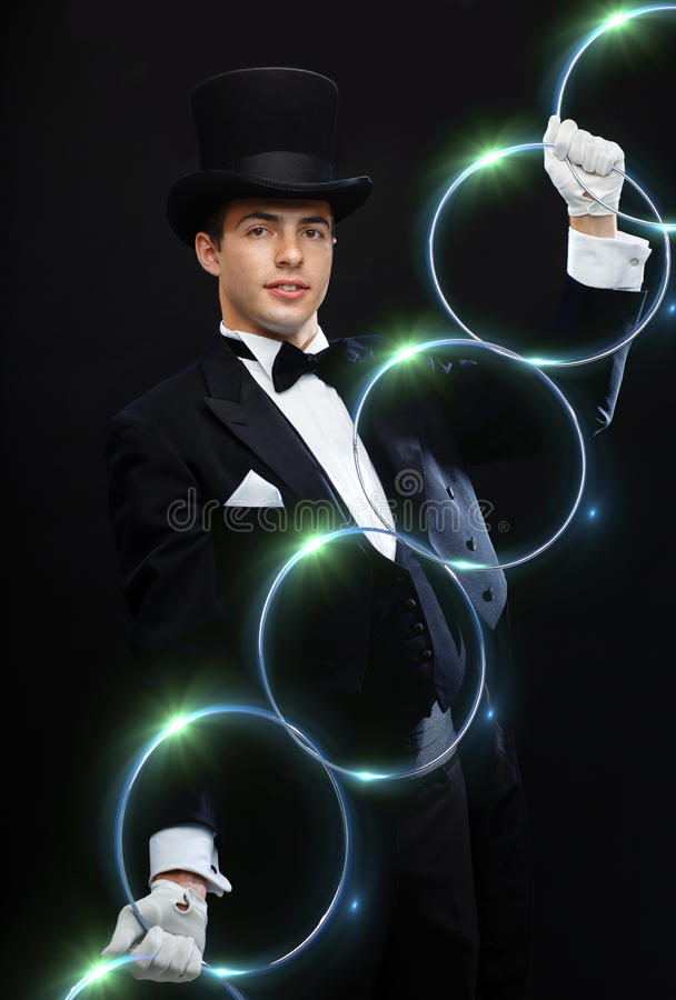 Magician showing trick with linking rings royalty free stock photography