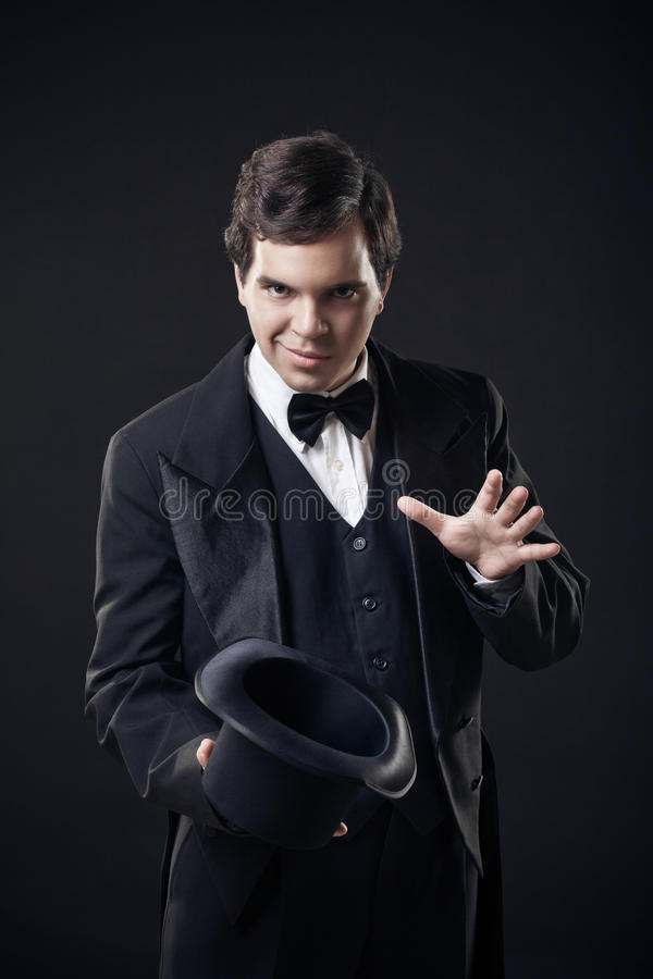 Download Magician Showing Tricks With Top Hat Isolated Stock Photo - Image: 26366592