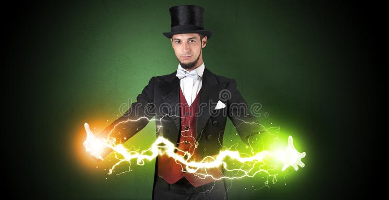 Magician energy between his hands. Magician sparkling super power between his two hands royalty free stock image