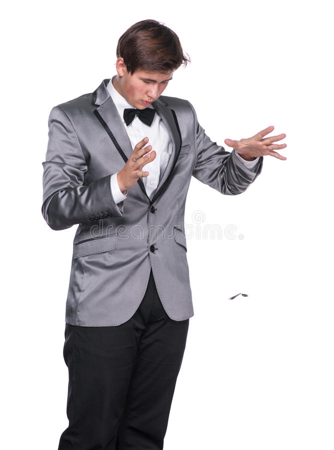 Download Magician Using Telekinetic Powers Stock Photo - Image of suit, cutlery: 29933190