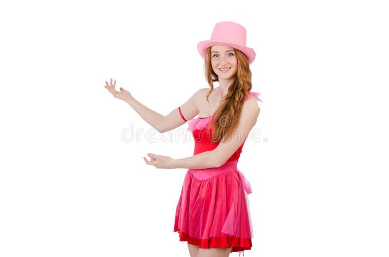 Magicien assez jeune dans la mini robe rose d'isolement dessus image stock