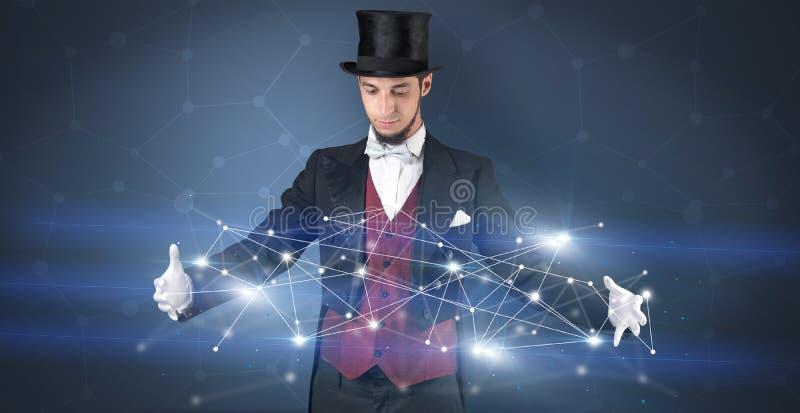 Magicien avec la connexion géométrique sur sa main images stock