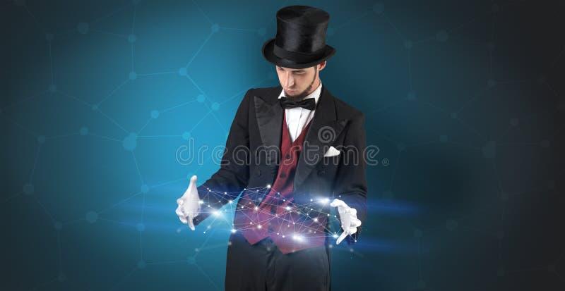 Magicien avec la connexion géométrique sur sa main photographie stock