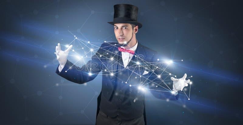 Magicien avec la connexion géométrique sur sa main image stock