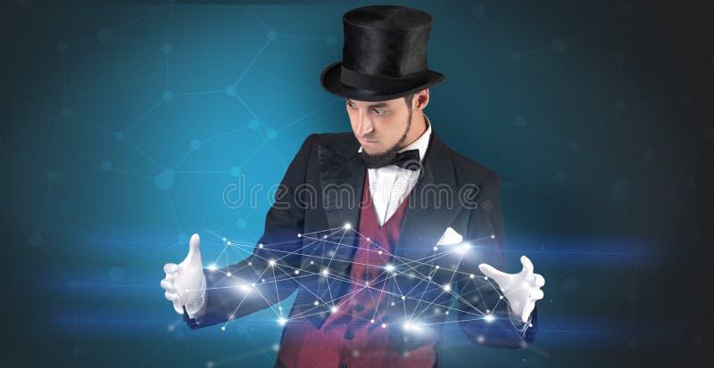 Magicien avec la connexion géométrique sur sa main images libres de droits