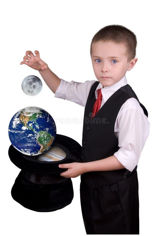 Magicien d'enfant avec des planètes photos stock