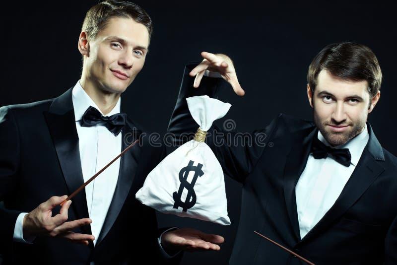 Magiciens d'affaires images stock