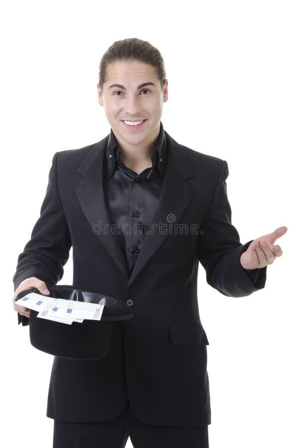 Magier mit Geld im Spitzenhut stockfoto