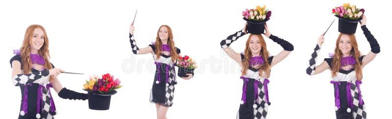 Magik kobieta z kwiatami na bielu obraz stock