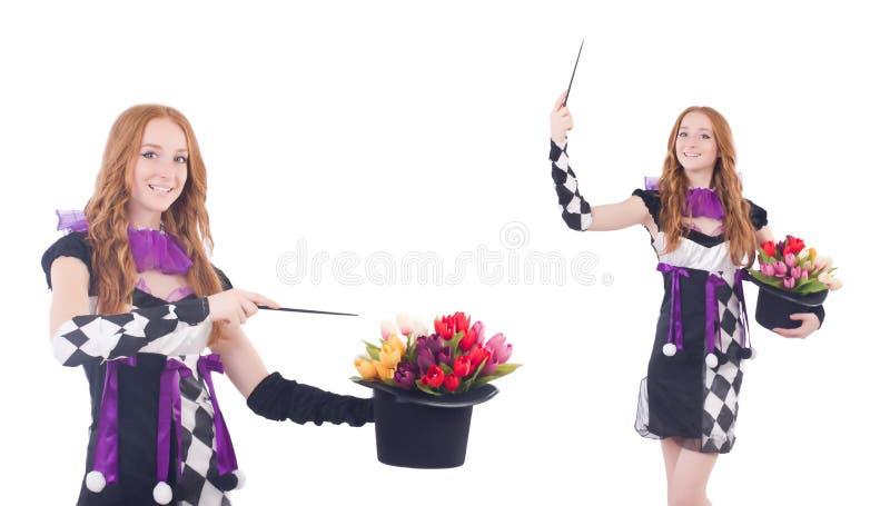 Magik kobieta z kwiatami na bielu fotografia royalty free