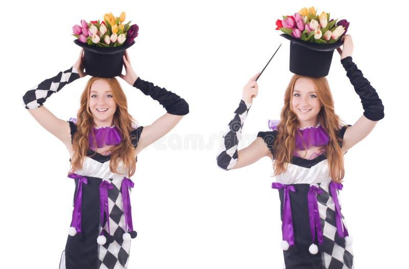 Magik kobieta z kwiatami na bielu zdjęcia stock