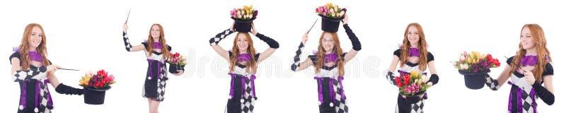 Magik kobieta z kwiatami na bielu zdjęcie royalty free