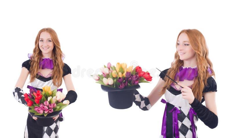 Magik kobieta z kwiatami na bielu fotografia stock