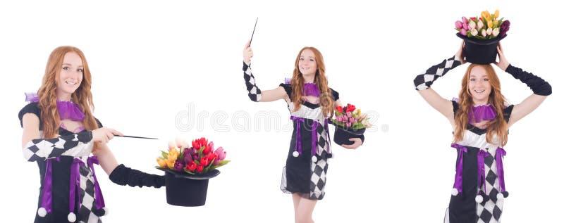 Magik kobieta z kwiatami na bielu zdjęcie stock
