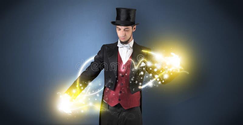 Magik trzyma jego władzę na jego ręce zdjęcie stock
