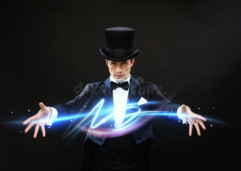 Magik w odgórnego kapeluszu seansu sztuczce fotografia stock