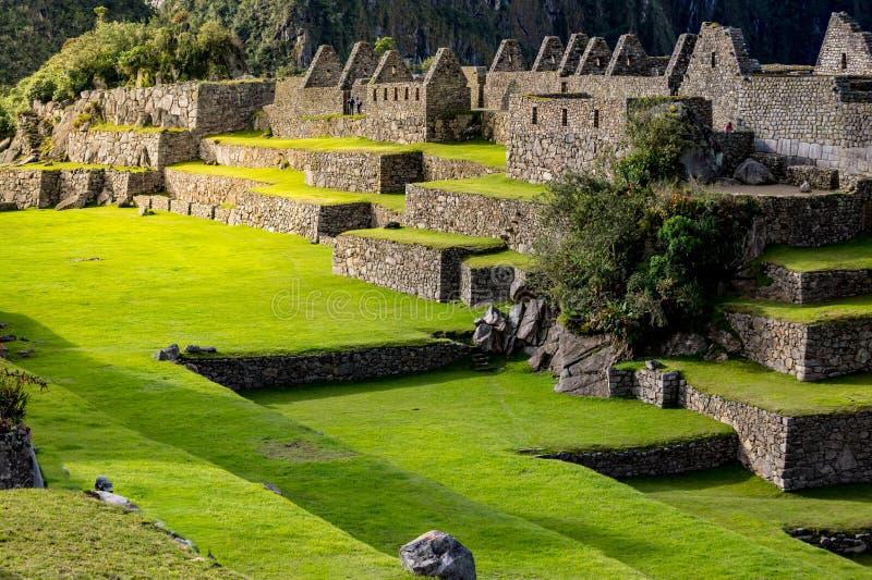 Magische de steengebouwen van Machu Picchu van middag lichte aanrakingen stock foto's