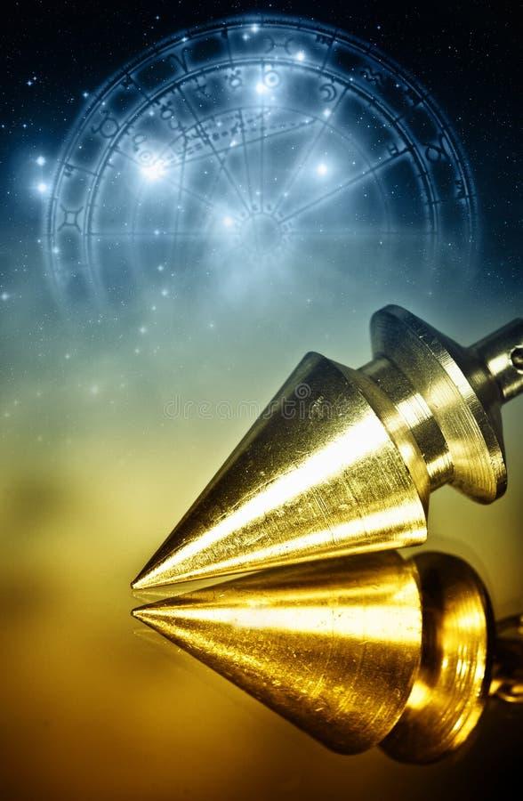 magisk klockpendel royaltyfria bilder