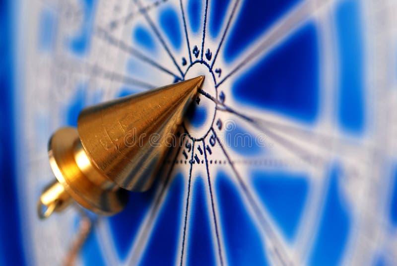 magisk klockpendel fotografering för bildbyråer