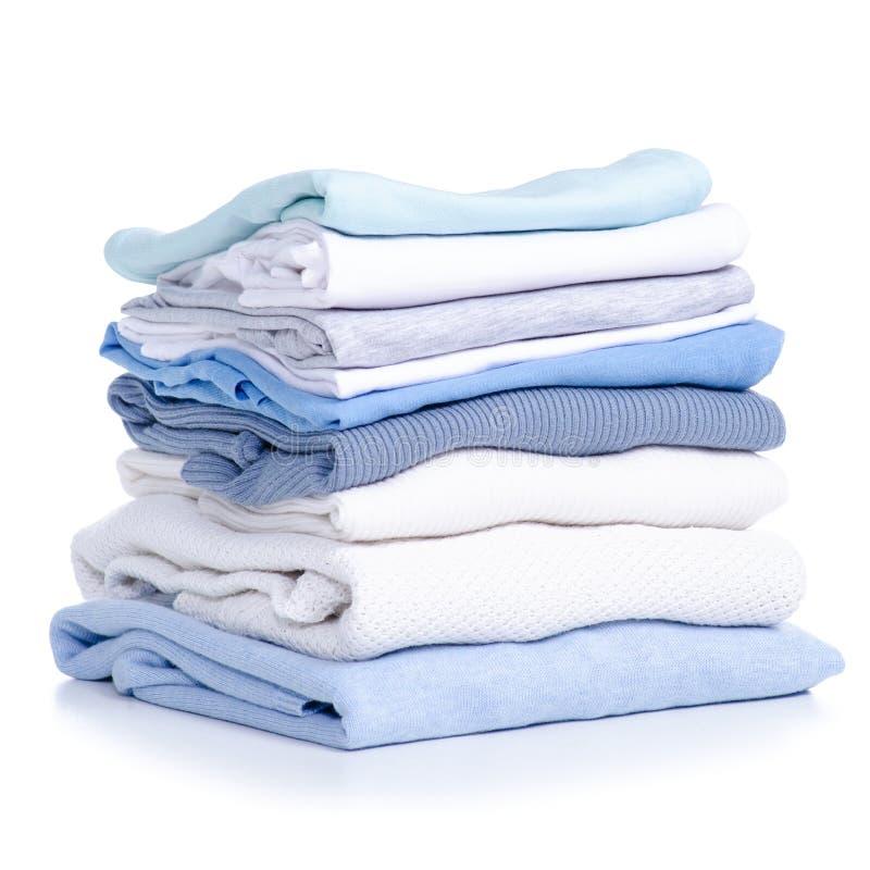 Maglietta bianca blu del maglione dell'abbigliamento della pila fotografie stock