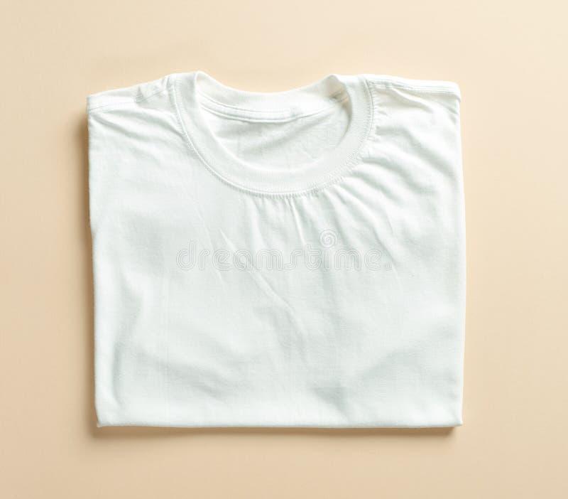 Maglietta piegata bianco immagini stock