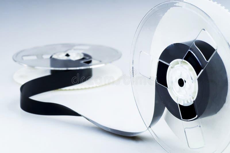 Magneetbandwond op spoelen stock foto