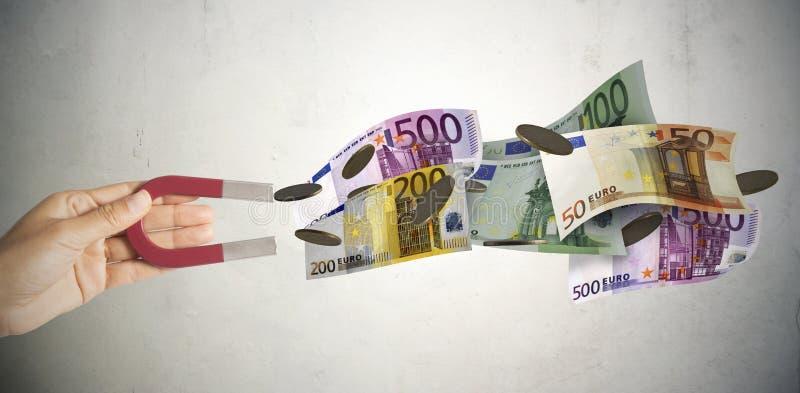 Magnes przyciąga pieniądze zdjęcia stock