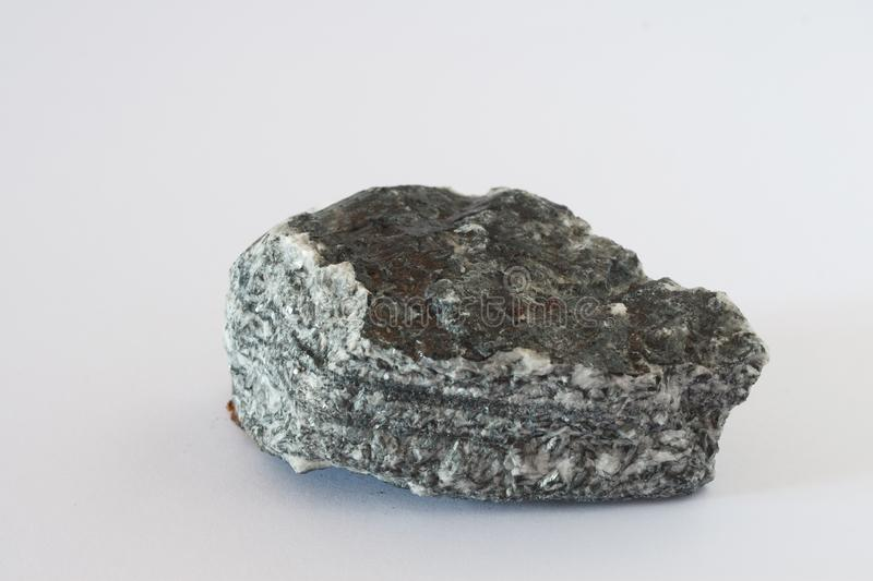 Magnesite mineral on white background. Magnesite mineral, mixed crystals of iron carbonate and magnesite also magnesium ore from carbonate class on white stock image